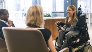 woman in wheelchair being interviewed for a job