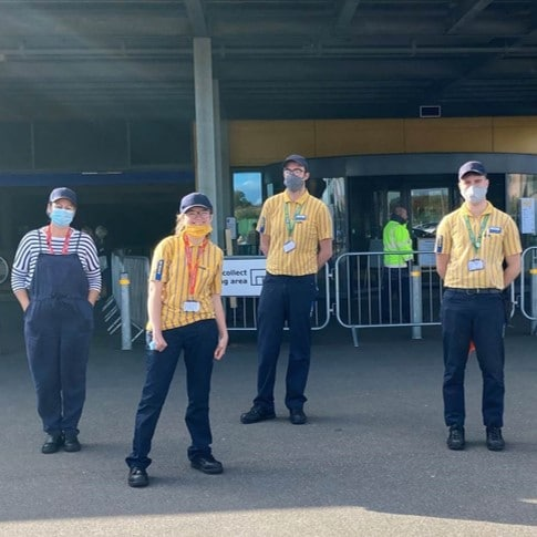 4 people standing in front of IKEA Exeter's store entrance